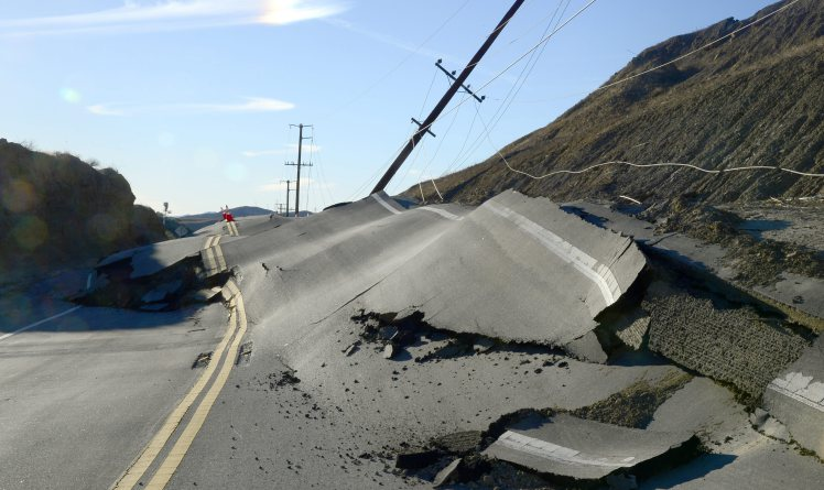 epa05035278 A portion of Vasquez Canyon Road near Santa Clarita, California, USA, 20 November 2015. Reports state that a landslide buckled and damaged the road. A 2-mile portion of the popular Canyon Country road will remain closed as the road is repaired and electrical and telephone lines are fixed. EPA/MIKE NELSON